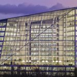 Showing the Edge, the most sustainable office building in Amsterdam built by OVG at night