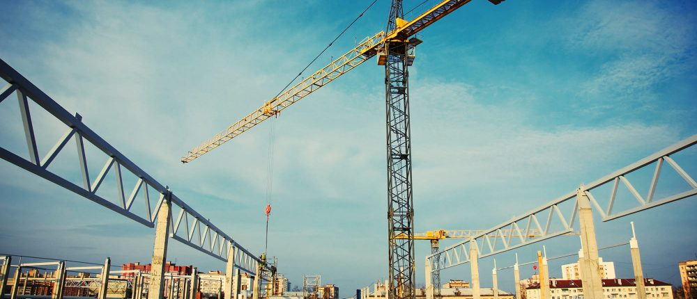 A construction crane on a construction site illustrating illustrating the project delivery phase of construction