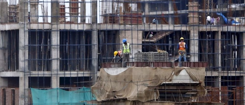 Workers on construction site in developing country with basic health & safety protection